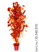 Red pepper mixture with peanuts, sesame seeds and chinese spices on white background. Стоковое фото, фотограф Марина Володько / Фотобанк Лори