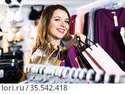 Female shopper boasting her purchases in underwear shop. Стоковое фото, фотограф Яков Филимонов / Фотобанк Лори