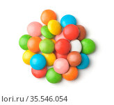 Pile of colorful glazed button candies isolated on white. Стоковое фото, фотограф Zoonar.com/Anton Starikov / easy Fotostock / Фотобанк Лори