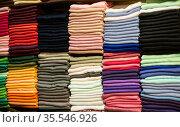 Pile of bright Multi-colored pieces of fabric in a bazaar. Стоковое фото, фотограф Turgay Koca / easy Fotostock / Фотобанк Лори
