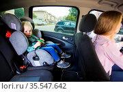Toddler boy sitting in a car seat behind her nanny. Стоковое фото, фотограф Zoonar.com/OKSANA SHUFRYCH / easy Fotostock / Фотобанк Лори