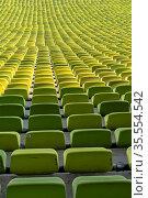 Many endless rows of enpty chairs in a stadium. Стоковое фото, фотограф Zoonar.com/Nando Lardi / easy Fotostock / Фотобанк Лори