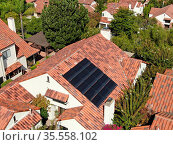 Aerial top view of residential villas with solar panel on the roof... Стоковое фото, фотограф Zoonar.com/Thomas De Wever / age Fotostock / Фотобанк Лори