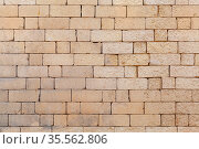 Old stone wall made of yellow bricks, photo texture. Стоковое фото, фотограф EugeneSergeev / Фотобанк Лори