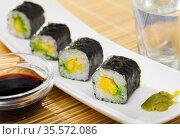 Japanese cuisine - Maki roll with avocado. Стоковое фото, фотограф Яков Филимонов / Фотобанк Лори