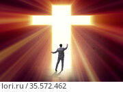 Religious concept with cross and lonely man. Стоковое фото, фотограф Elnur / Фотобанк Лори
