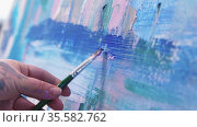 A woman paint artist drawing an abstract painting with a brush and oil paints. Стоковое видео, видеограф Константин Шишкин / Фотобанк Лори
