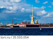 View of the Peter and Paul Fortress across the Neva River, iconic... Стоковое фото, фотограф Zoonar.com/Ruslan Gilmanshin / easy Fotostock / Фотобанк Лори
