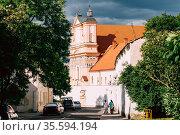 Grodno, Belarus. People Walking Near Catholic Church Of The Annunciation... Стоковое фото, фотограф Ryhor Bruyeu / easy Fotostock / Фотобанк Лори