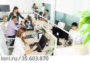 People working with computers and laptops in modern office. Стоковое фото, фотограф Яков Филимонов / Фотобанк Лори