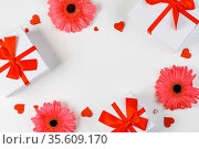 Pink gerbera flowers gifts and red hearts composition on white background... Стоковое фото, фотограф Zoonar.com/Ivan Mikhaylov / easy Fotostock / Фотобанк Лори