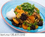 Lamb pilau with dried fruits and greens. Стоковое фото, фотограф Яков Филимонов / Фотобанк Лори