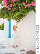 Cute girl in blue dresses having fun outdoors on Mykonos streets. Стоковое фото, фотограф Дмитрий Травников / Фотобанк Лори
