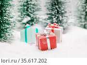 Christmas gifts in fir tree forest under snow. Стоковое фото, фотограф Zoonar.com/Ivan Mikhaylov / easy Fotostock / Фотобанк Лори