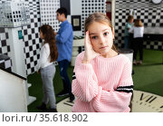 Pensive girl trying to find solution of conundrum to get out of room. Стоковое фото, фотограф Яков Филимонов / Фотобанк Лори