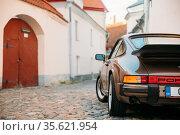 Tallinn, Estonia Rear View Of Porsche 930 Car Parked In Old Narrow... Стоковое фото, фотограф Ryhor Bruyeu / easy Fotostock / Фотобанк Лори