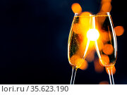 Two glasses of champagne clinking with sparklers bokeh lights in the... Стоковое фото, фотограф Zoonar.com/Ivan Mikhaylov / easy Fotostock / Фотобанк Лори