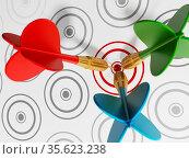 Three darts hitting red target among gray ones. Стоковое фото, фотограф Zoonar.com/Cigdem Simsek / easy Fotostock / Фотобанк Лори
