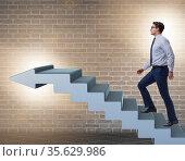 Businessman climbing career ladder in business concept. Стоковое фото, фотограф Elnur / Фотобанк Лори