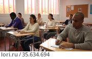 Portrait of a student at a desk in a university audience. Стоковое видео, видеограф Яков Филимонов / Фотобанк Лори