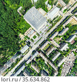 Aerial city view with crossroads and roads, houses, buildings, parks and parking lots. Sunny summer panoramic image. Стоковое фото, фотограф Александр Маркин / Фотобанк Лори