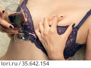 Woman in bra with wineglass squeeze her breasts. Стоковое фото, фотограф Zoonar.com/A.Tugolukov / easy Fotostock / Фотобанк Лори