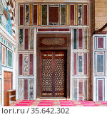 Old colorful marble wall with wooden door decorated with arabesque... Стоковое фото, фотограф Zoonar.com/Khaled ElAdawy / easy Fotostock / Фотобанк Лори
