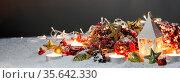 Christmas composition of lantern colorful ornaments balls stars candles... Стоковое фото, фотограф Zoonar.com/Ivan Mikhaylov / easy Fotostock / Фотобанк Лори