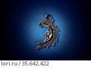 The Moon talisman, a symbol of the Wiccan Goddess on a dark blue background... Стоковое фото, фотограф Zoonar.com/Katerina Solovyeva / easy Fotostock / Фотобанк Лори