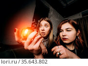 Woman and woman fortune teller with illuminated crystal ball, close... Стоковое фото, фотограф Zoonar.com/Oleksii Hrecheniuk / easy Fotostock / Фотобанк Лори
