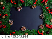 Natural fir Christmas tree border frame with decor on black, copy... Стоковое фото, фотограф Zoonar.com/Ivan Mikhaylov / easy Fotostock / Фотобанк Лори