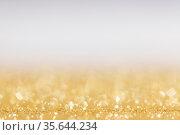 Abstract golden glitter background of shiny lights bokeh Christmas... Стоковое фото, фотограф Zoonar.com/Ivan Mikhaylov / easy Fotostock / Фотобанк Лори