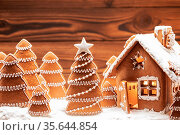 Gingerbread house christmas fir trees cookies in snow winter holiday... Стоковое фото, фотограф Zoonar.com/Ivan Mikhaylov / easy Fotostock / Фотобанк Лори