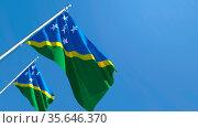 3D rendering of the national flag of Solomon Islands waving in the... Стоковое фото, фотограф Zoonar.com/Aleksey Butenkov / easy Fotostock / Фотобанк Лори