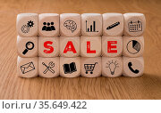 Dice with icons and the word Sale. Стоковое фото, фотограф Zoonar.com/Boris Zerwann / easy Fotostock / Фотобанк Лори