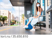 Virus protection in public transportation. Woman traveling wearing... Стоковое фото, фотограф Zoonar.com/DAVID HERRAEZ CALZADA / easy Fotostock / Фотобанк Лори