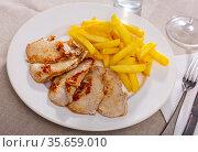 Roasted pork tenderloin served with fried potato. Стоковое фото, фотограф Яков Филимонов / Фотобанк Лори