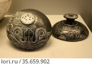 Steatite and serpentine two-piece vase with pierced base and relief... Редакционное фото, агентство World History Archive / Фотобанк Лори