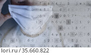 Numbers and letters over caucasian female medical worker, coronavirus and healthcare concept. Стоковое фото, агентство Wavebreak Media / Фотобанк Лори