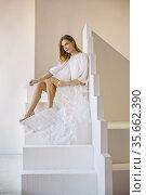 Attractive woman with angel wings poses in the studio. Стоковое фото, фотограф Алексей Кузнецов / Фотобанк Лори