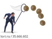 Businessman chasing bitcoins in cryptocurrency concept. Стоковое фото, фотограф Elnur / Фотобанк Лори