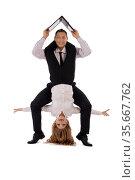 Excited colleagues with laptop doing acrobatic trick. Стоковое фото, фотограф Гурьянов Андрей / Фотобанк Лори