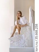 Attractive woman with angel wings posing in the studio. Стоковое фото, фотограф Алексей Кузнецов / Фотобанк Лори
