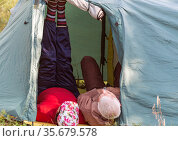mature sports couple resting in nature in a tent in love and harmony on a summer day. Стоковое фото, фотограф Акиньшин Владимир / Фотобанк Лори