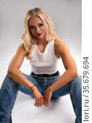 Strong blond female model in casual clothes. Стоковое фото, фотограф Гурьянов Андрей / Фотобанк Лори