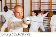 Male training at fencing workout. Стоковое фото, фотограф Яков Филимонов / Фотобанк Лори