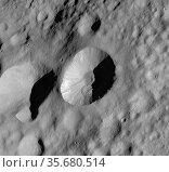 This Dawn framing camera (FC) image of Asteroid Vesta shows Licinia... Редакционное фото, агентство World History Archive / Фотобанк Лори