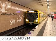 Berlin, Germany, subway of the line 9 enters the station Zoologischer Garten. Редакционное фото, агентство Caro Photoagency / Фотобанк Лори