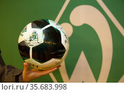 Germany, Bremen - match ball of the Bundesliga soccer team Werder Bremen with the autographs of the current squad. Редакционное фото, агентство Caro Photoagency / Фотобанк Лори