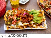 Nachos with meat, vegetables and Guacamole. Стоковое фото, фотограф Яков Филимонов / Фотобанк Лори